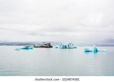 Jokulsarlon Glacier Lagoon,  landscape  full of broken icebergs floating in the lagoon on the way to the sea. One of the most important touristic atractions in Iceland due to his beauty