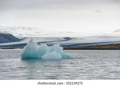 Jokulsarlon Glacier Lagoon and Mountain in Background. Peace of Ice in Foreground