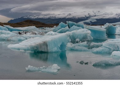 Jokulsarlon Glacier Lagoon and Mountain in Background. Icebergs in Water