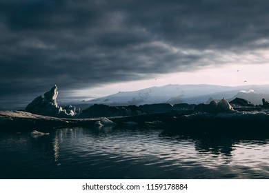 Jokulsarlon and Fjallsárlón glacier lagoon on the sunset many icebergs floating swimming passing by everywhere reflection of the sky in the glacial water