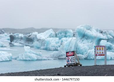 JOKULSARLON, ICELAND - MAY 21, 2019: Do not walk on the ice sign warning tourists to keep them safe in Jokulsarlon glacial lagoon