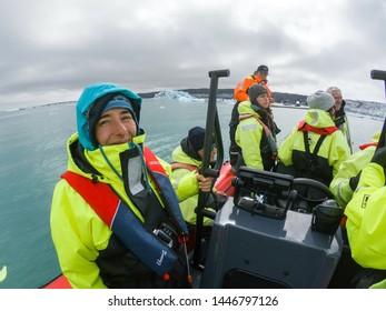 JOKULSARLON, ICELAND - MAY 23, 2019: Tourists taking a boat trip on Jokulsarlon glacial lagoon