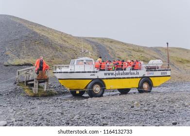 JOKULSARLON, ICELAND - September 3: Tourists on a boat in Jokulsarlon lagoon in Iceland September 3, 2017.