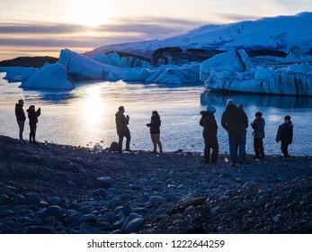 JOKULSARLON, ICELAND-OCTOBER 17, 2018:Tourists at the Jokulsarlon glasier lagoon in Iceland in evening
