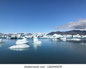 Jokulsarlon lagoon / glacier lake in Iceland. Blue icebergs Beautiful cold landscape Icelandic glacier lagoon bay.  Vatna glacier, Vatnajokull National park. Global warming concept
