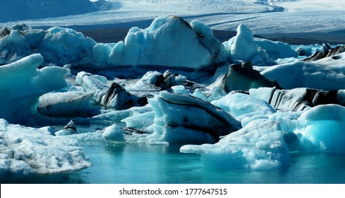 Jokulsarlon-large glacial lake. Vatnajokull National Park, Iceland. The lagoon is formed from melted glacial water, perpetually growing while big blocks of ice crumble from the ever-shrinking glacier