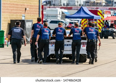 Joliet, IL, United States - June 29, 2019: Hendrick Motorsports crew pushing one of their NASCAR cars before Camping World 300 at Chicagoland Speedway.