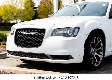 JOLIET, IL, USA - APRIL 28, 2019: The front end of a white 2018 Chrysler 300 with a beautiful bokeh / blurred background.