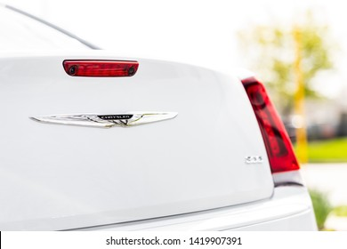 JOLIET, IL, USA - APRIL 28, 2019: The rear end of a white 2018 Chrysler 300 with a beautiful bokeh / blurred background.