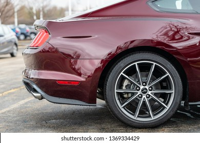 JOLIET, IL, USA - APRIL 7, 2019: The rear end of a burgundy 2018 Ford Mustang, which has models ranging from 310 to 460 horsepower.