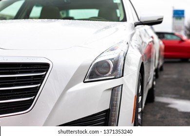 JOLIET, IL, USA - APRIL 7, 2019: The front end of a white 2016 Cadillac CTS Luxury Collection AWD. The model comes with 335 horsepower and an 8 speed transmission.
