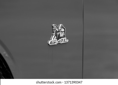 JOLIET, IL, USA - APRIL 7, 2019: The Scat Pack symbol of a 2018 Dodge Challenger R/T Scat Pack, which features 485 horsepower with its 6.4L engine. Black and white.