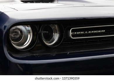 JOLIET, IL, USA - APRIL 7, 2019: The front end of a blue 2017 Dodge Challenger GT AWD, which features a 305 horsepower engine.