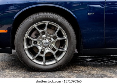 JOLIET, IL, USA - APRIL 7, 2019: The wheel well of a blue 2017 Dodge Challenger GT AWD, which features a 305 horsepower engine.