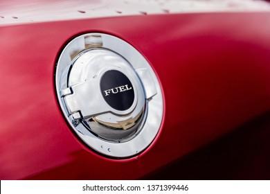 JOLIET, IL, USA - APRIL 7, 2019: The gas cap of a Octane Red 2018 Dodge Challenger SXT Plus, which features a 305 horsepower HEMI engine.
