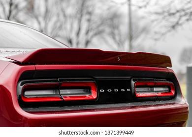 JOLIET, IL, USA - APRIL 7, 2019: The read end of an Octane Red 2018 Dodge Challenger SXT Plus, which features a 305 horsepower HEMI engine.