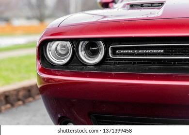 JOLIET, IL, USA - APRIL 7, 2019: The front end of an Octane Red 2018 Dodge Challenger SXT Plus, which features a 305 horsepower HEMI engine.