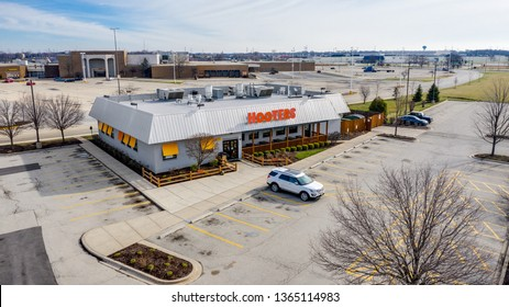 """JOLIET, IL, USA - APRIL 8, 2019: Hooters is an American chain restaurant that is known for its chicken wings, burgers, drinks and """"Hooter Girls"""" with over 420 restaurants in 29 countries."""