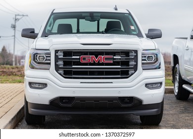 JOLIET, IL, USA - APRIL 9, 2019: The front end of a white 2018 GMC Sierra 1500 SLT 4WD., which has a towing capacity of 6,200 lbs.