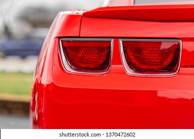 JOLIET, IL, USA - APRIL 9, 2019: The tail light of a Victory Red 2013 Chevrolet Camaro SS, the horsepower on these models range from 323 to 580 horsepower.