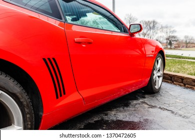 JOLIET, IL, USA - APRIL 9, 2019: The side of a Victory Red 2013 Chevrolet Camaro SS, the horsepower on these models range from 323 to 580 horsepower.