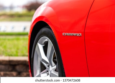JOLIET, IL, USA - APRIL 9, 2019: The logo of a 2013 Chevrolet Camaro SS, the horsepower on these models range from 323 to 580 horsepower.