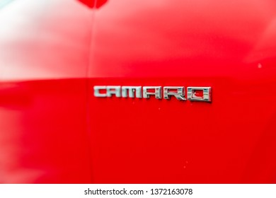 JOLIET, IL, USA - APRIL 9, 2019: A Victory Red 2013 Chevrolet Camaro SS, the horsepower on these models range from 323 to 580 horsepower. Shallow depth of field.