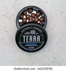 Joliet, IL / USA - May 13, 2019: An open container of medical cannabis chocolate candy. Marijuana infused chocolate covered blueberries are a medicinal cannabis product.