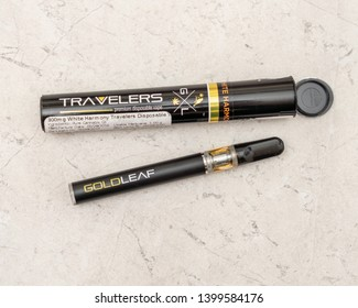 Joliet, IL / USA - May 14, 2019: Medical marijuana product, a disposable vape pen or e-cigarette filled with cannabis oil as purchased at an Illinois Medical Cannabis Dispensary