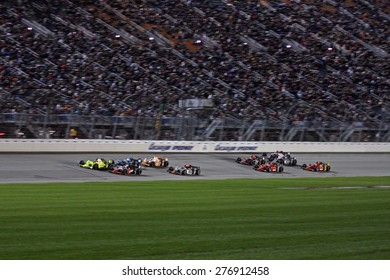 Joliet Illinois, USA - August 29, 2009: IndyCar Racing League. Nighttime Race action on track, cars running wheel to wheel, Chicagoland speedway.