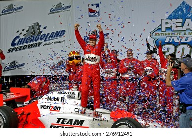 Joliet Illinois, USA - August 29, 2009: IndyCar Racing League. Victory Circle with Ryan Brisco, race winner. Penske racing team, Chicagoland speedway.