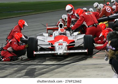 Joliet Illinois, USA - August 29, 2009: IndyCar Racing League. Pit stop. Ryan Brisco driver, Penske racing team. Team changes tires and fuels the car. Chicagoland speedway. Night Racing under lights.