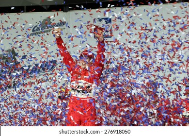 Joliet Illinois, USA - August 29, 2009: IndyCar Racing League. Victory Circle with Ryan Brisco, race winner. Penske racing team, Chicagoland speedway.  Peak Antifreeze & Motor Oil Indy 300
