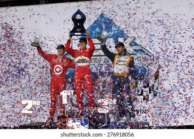 Joliet Illinois, USA - August 29, 2009: IndyCar Racing. Victory Circle Podium - Scott Dixon 2nd, Ryan Brisco, winner, Mario Moraes 3rd,  Chicagoland speedway.  Peak Antifreeze and Motor Oil Indy 300