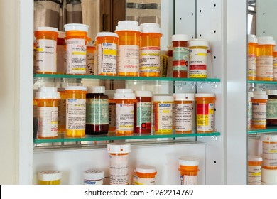 Joliet, Illinois / USA - October 29, 2017: A medicine cabinet full of prescription drug bottles. Medicines include prescription opioid pain killers.