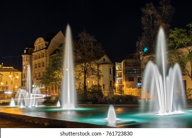 Joliot Curie Square in the city of Halle Saale in Germany at night with a beautiful fountain