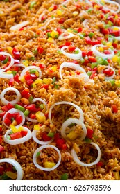 Jollof rice also called Benachin is a one-pot rice dish popular in many West African countries.