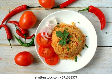 "Jollof rice also called Benachin (Wolof: ""one pot""), is a one-pot rice dish popular in many West African countries, eaten whenever desired. It is a West African version of pilaf or paella."