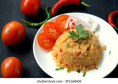 """Jollof rice also called Benachin (Wolof: """"one pot""""), is a one-pot rice dish popular in many West African countries, eaten whenever desired. It is a West African version of pilaf or paella."""