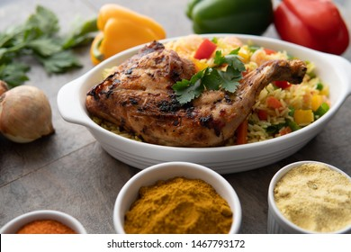 Jollof Rice and Chicken Dish with Peppers and Salad. African - Nigerian Jollofrice and Chicken Dish with Peppers and Salad. Nigeria Cuisine. Tasty Chicken African Cuisine. Grilled Chicken Food