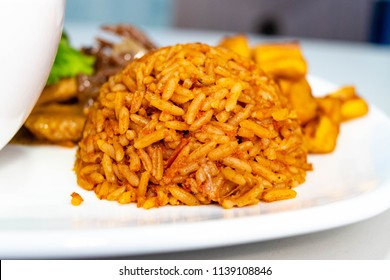 Jollof rice dome for Nigerian Ghanaian food concept. Wolof. West African Dish of Jollof Rice also called Benachin,  pilaf or paella, Byriani South Asian Cuisine