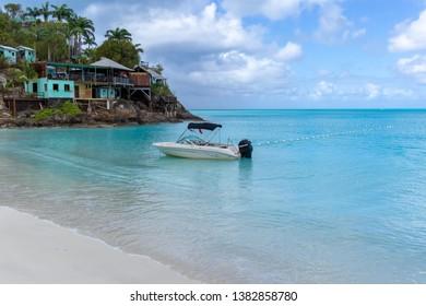 Jolly Beach / Antigua - 04 14 2018: Speedboat moored in the beautiful clear blue waters off Jolly Beach in Antigua