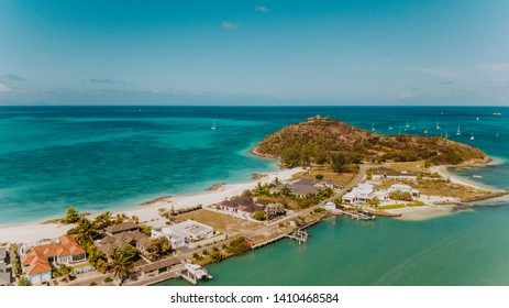 Jolly beach in Antigua, the most beautiful beach in Jolly Harbour, tropical Caribbean island with turquoise water and white sand, Caribbean islands luxury life, perfect place for a honeymoon