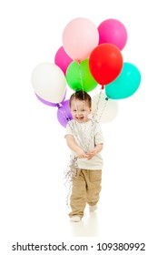 Jolly funny child boy with bunch of colourful balloons in his hands. Isolated on white.
