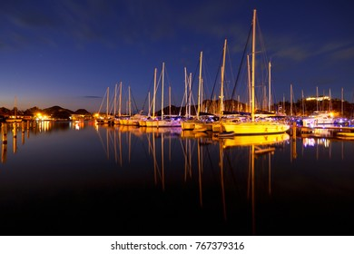 Jolly Harbor in Antigua with sailboats and reflection shortly after sunset.