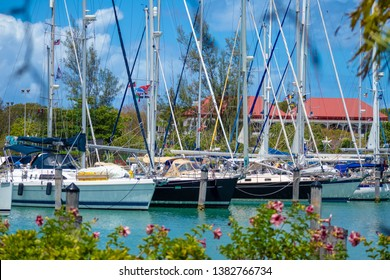 Jolly Harbour, St. Mary / Antigua - 04 15 2018: Yachts lined up in Jolly Harbour, St. Mary, Antigua