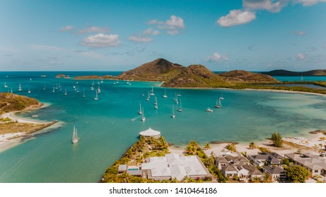 Jolly Harbour view in Antigua with tropical nature, sailboats anchoring in a bay, Caribbean sea, in the blue water, lagoon, sailing in the Caribbean islands