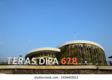 Jombang, Indonesia - June 24, 2019: Car park in Rest area of Teras Dipa 678 Trns Java toll with facilities for mosques, restaurants and store stands in Jombang, East Java, Indonesia