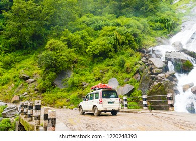 Jomsom, Mustang, Nepal - July 30, 2018 : Off road vehicles with tourists crossing river on the road to Pokhara, in Annapurna Conservation Area, Nepal's largest protected area.