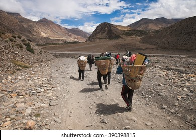 JOMSOM, NEPAL - SEPT 12 - The locals go along the rural road on September 12, 2015. The road in Annaurna area for connecting village to village and very popular for trekking.